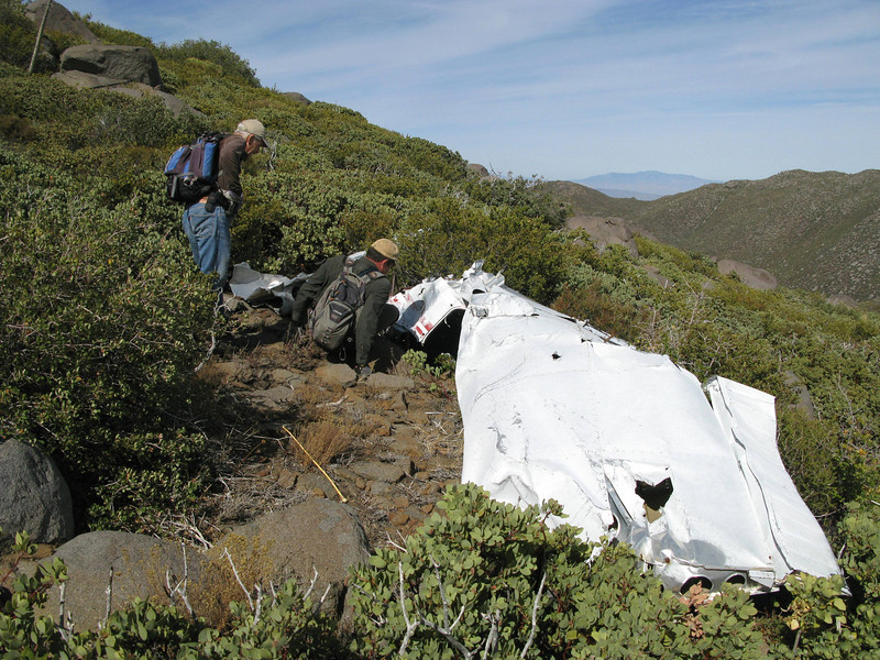 When we arrived at the main wreckage site, we noticed that the airplane was inverted with it's right wing still attached.