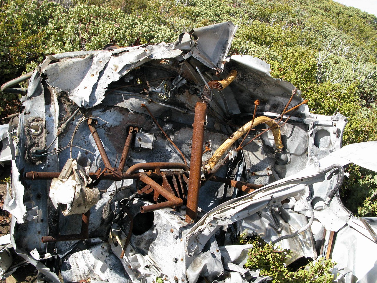 The cockpit of the Piper showed evidence of substantial impact damage as well as fire.