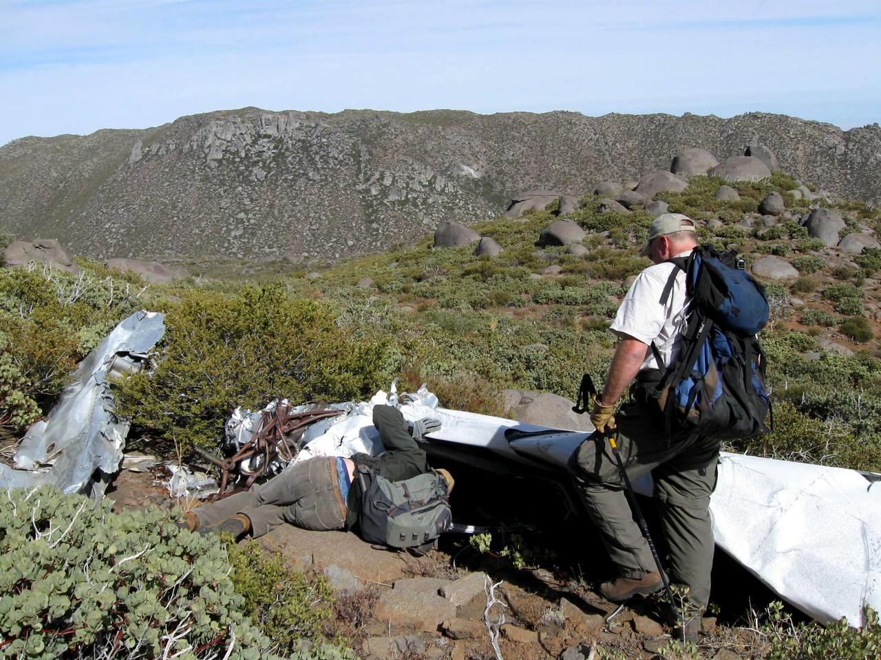 Trey examines the aircraft cabin area. (Photo courtesy of Steve Owen)
