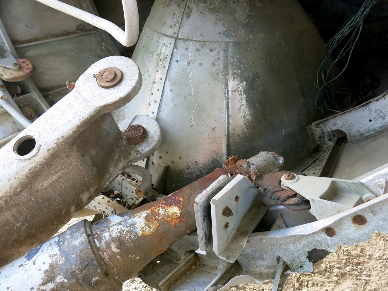 After the accident, the tailwheel assembly was still attached and probably remained attached during the wreckage recovery. <br /> <br /> This photo shows the tailwheel attach points cut by a saw and torch. This was most likely done after the investigation was completed.