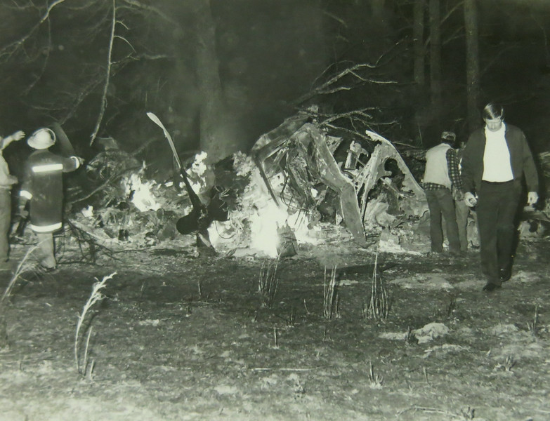 The photograph shows the left side of the aircraft with the left engine and propeller visible.<br /> <br /> Tesitmony from the surviving pilots mention the left engine continued operating and the propeller spinning after the aircraft came to a stop. The inflight and subsequent post crash fire soon consumed the aircraft within minutes.