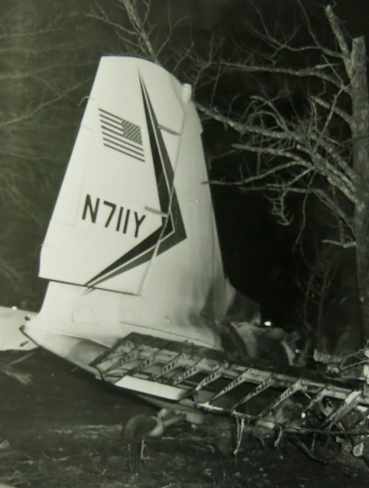 This phototograph of the tail section of N711Y illustrates that the inflight fire consumed right-side elevator flight control surface.<br /> <br /> The photograph also illustrates a smoke and soot pattern on the lower half of the vertical stabilizer that is characteristic of an inflight fire.