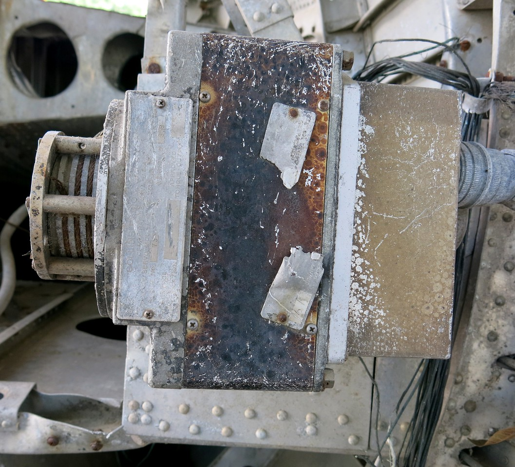Still attached to the aft fusealge fragment is the aircraft's auto-pilot pitch servo. The unit was manufactured by Collins Radio and still exihibited fire damage.