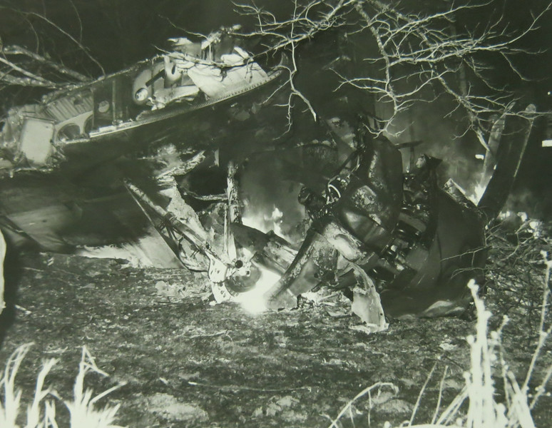 The number two engine and extended right main landing gear is visible in this photograph taken on the evening of the accident.