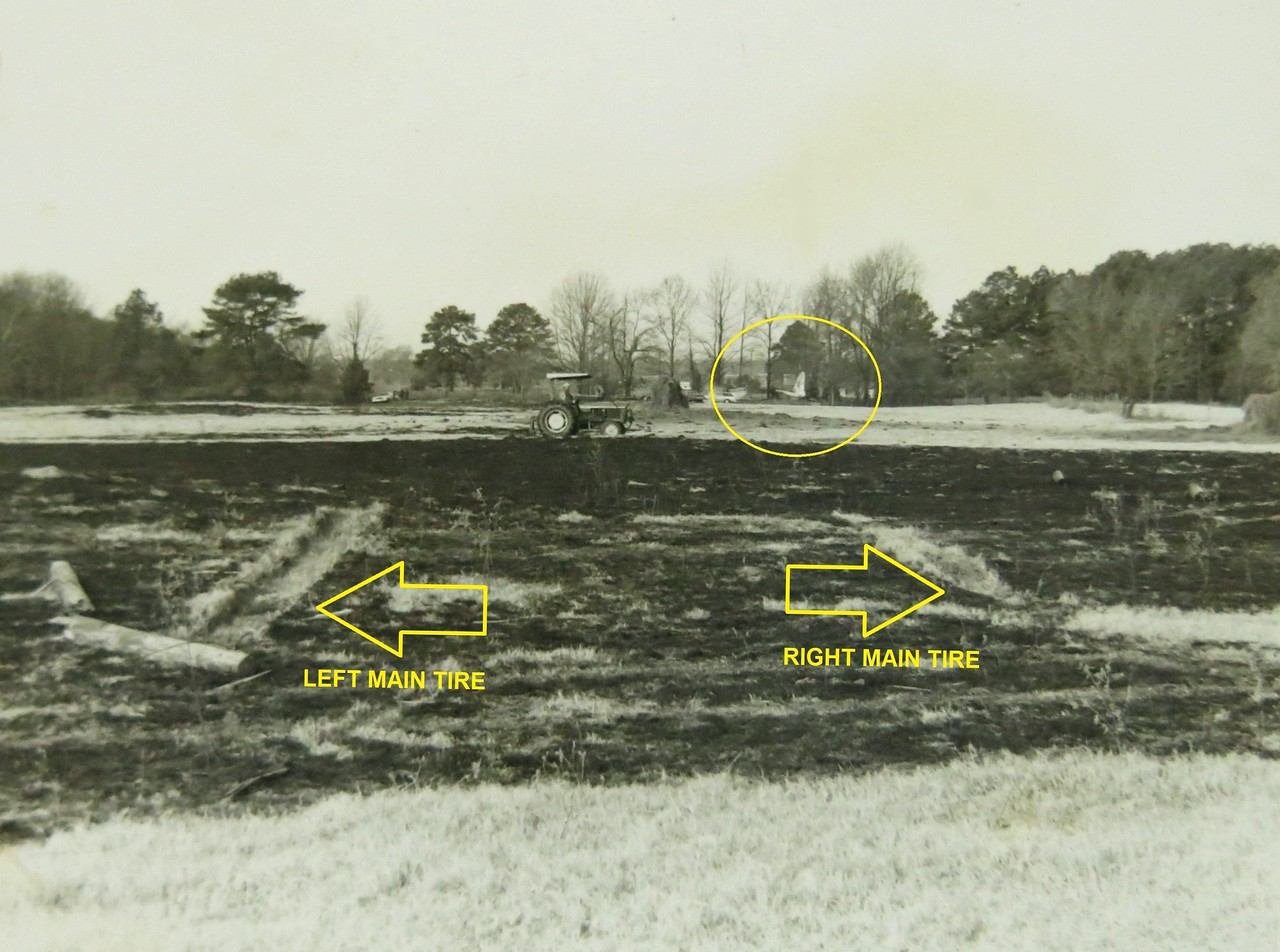 THE ACCIDENT<br /> <br /> With the wing flaps extended and the landing gear down, the aircraft approached the cow pasture. <br /> <br /> The aircraft struck a utility pole and clipped transmission lines with its right wing. With a majority of it's fabric elevator control surfaces burned away, The DC-3 slammed into the cow pasture leaving tire marks in the soft ground and a trail of fire.<br /> <br /> The aircraft bounced then rolled into a stand of trees at the far end of the field.