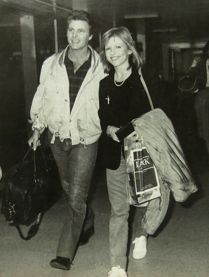 THE STONE CANYON BAND<br /> <br /> Rick Nelson was not only traveling on tour with his band, but was also traveling with his fiance, Helen Blair.<br /> <br /> In this photo, they are seen arriving at London's Heathrow Airport during a vacation in October 1985.
