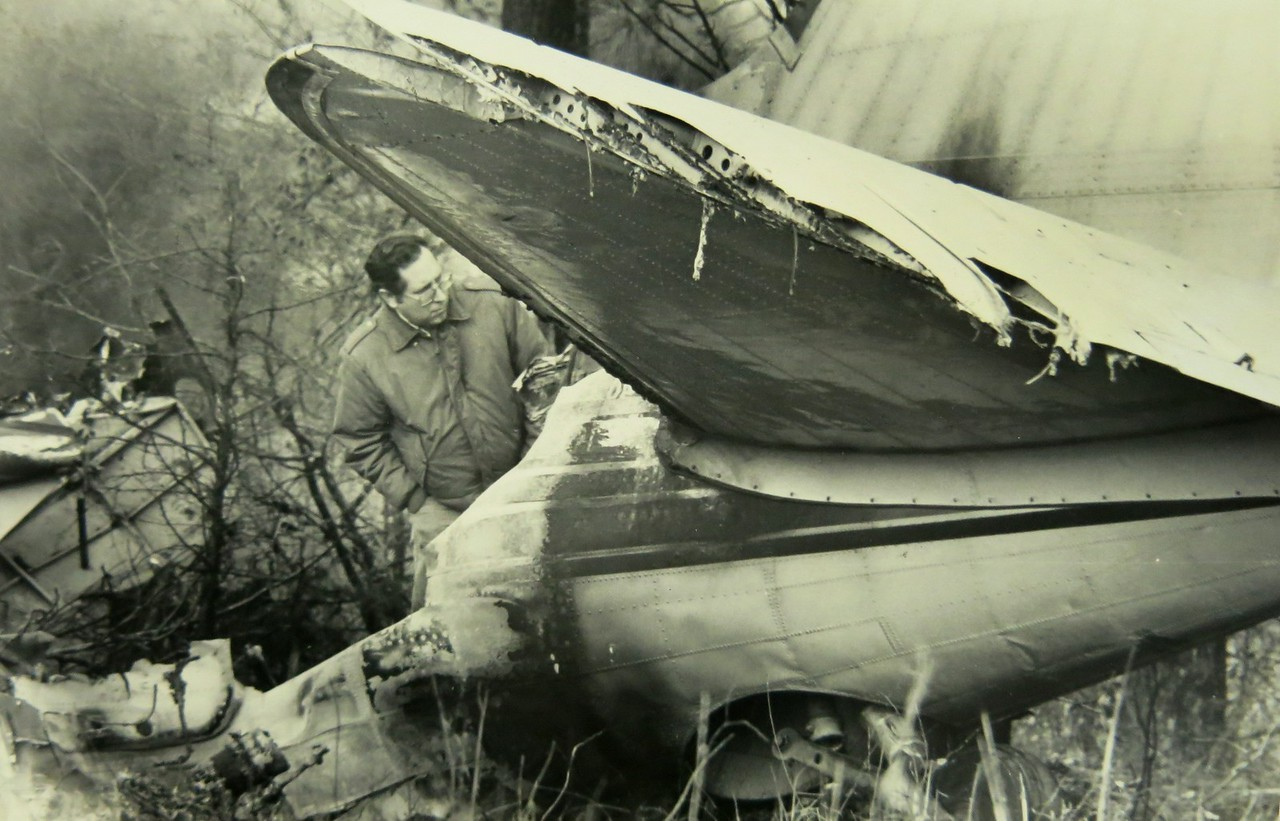 An NTSB investigator studies the tail section and in particular the 155,000 BTU Janitrol cabin heater that was installed near the tail section.<br />  <br /> The investigation began to center on the gasoline-fed cabin heater as a possible cause of the fire.