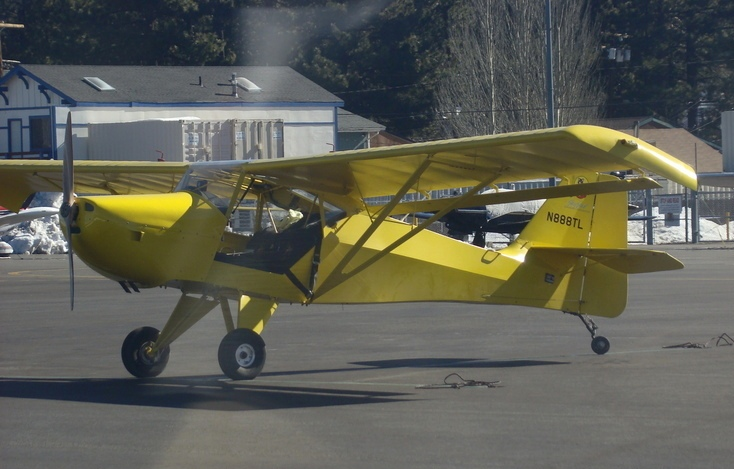 THE AIRCRAFT<br /> <br /> Leonard Trudy built the bright yellow Kitfox III (N888TL) in his garage in 1998. Issued serial number 980 by Kitfox Aircraft, LLC. the amateur-built experimental aircraft was powered by an 80 hp Rotax 912 engine. <br /> <br /> The aircraft was later sold to Darrell Boucher of Newport Beach, CA. in 2003.