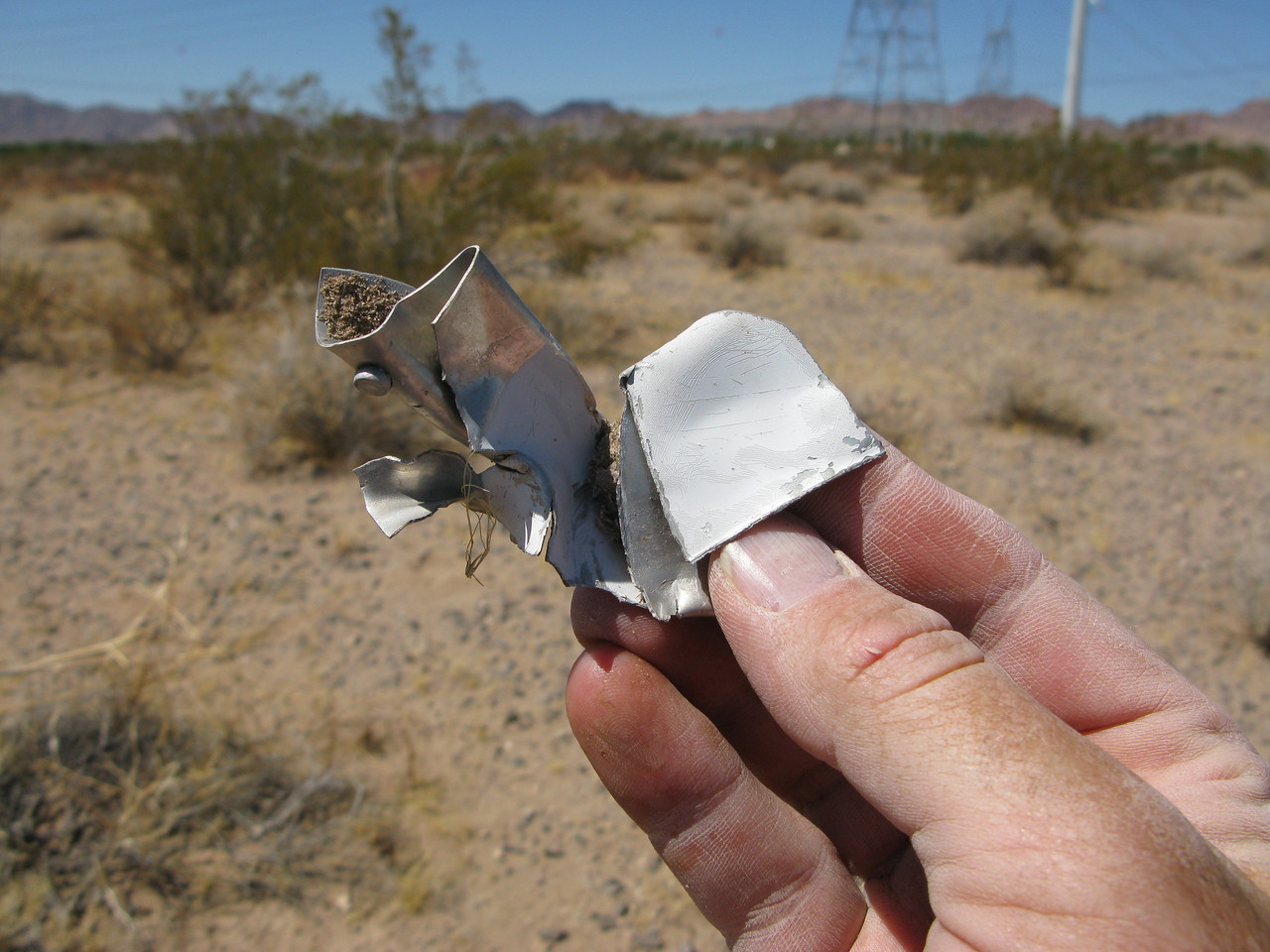 This piece of painted aircraft aluminum was the largest fragment located at the crash site.