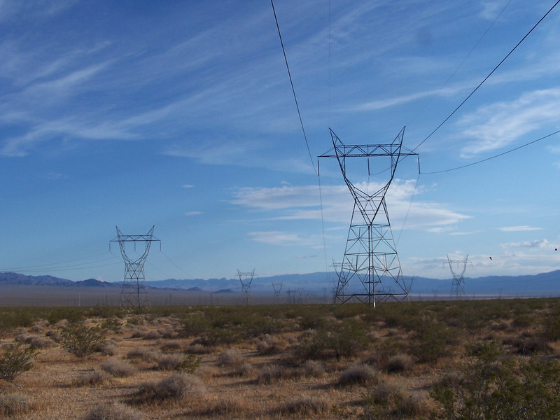 The power lines that surround the airport perimeter carry generated electric power from nearby Hoover Dam. Aircraft maintaining a safe distance from these towers and wires during takeoff and landing is a must.