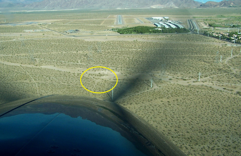 THE ACCIDENT<br /> <br /> The crash site of Piper N8098W is located just over a mile east of Boulder City Airport's Runway 27L.<br /> <br /> The crash site location is visible to any aircraft while on final approach to the airport from the east.
