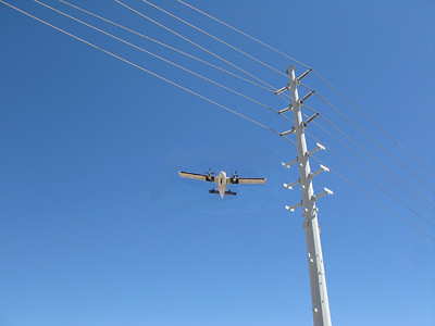 A normal flight path to Boulder City Airport's Runway 27L is aided with a VASI (Visual Approach Slope Indicator) System. The system allows aircraft to safely clear man-made obstructions such as powerlines surrounding the airport.