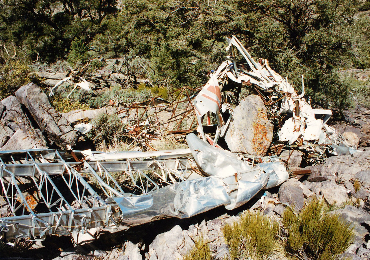 The inverted fuselage and left wing of the Piper among the boulders. <br /> <br /> The details of the accident were difficult to locate since there was no record of an accident report (the national database begins January 1962). There is also no record of the accident wreckage on the Civil Air Patrol's wreckage locator database.<br /> <br /> Fellow Aviation Archaeologist Joe Idoni searched online newspaper archives to bring this story to life. Thanks Joe!<br /> <br /> (THE END)