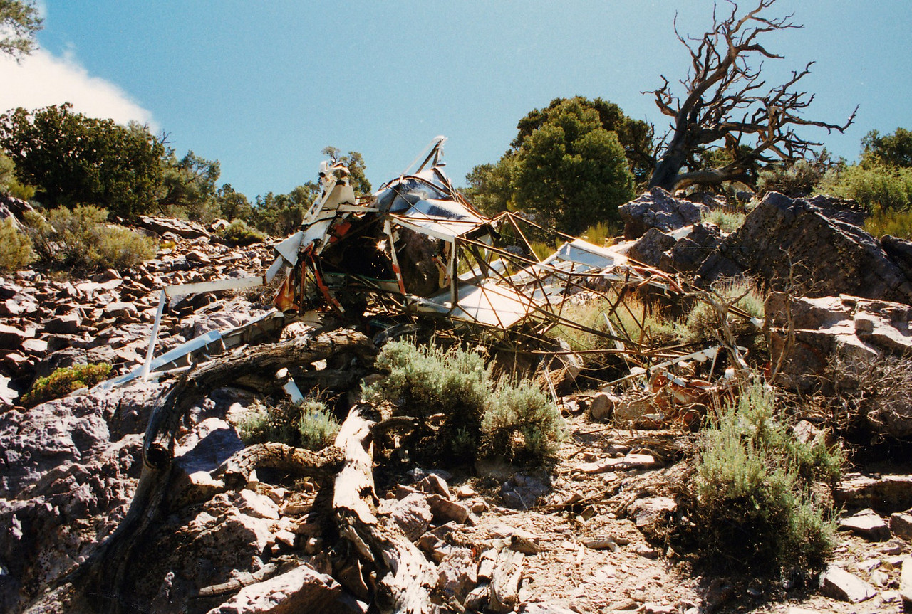 An overall view of the crash site. Personal effects located at the site were not many, but included discarded shoes.