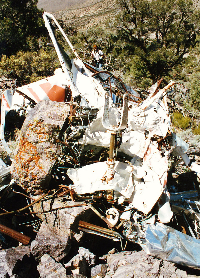 It was an ugly mangled wreck of a plane and it looked like it came down very steep and very hard. The wreckage was contained in a relatively small area suggesting a steep uncontrolled decent. <br /> <br /> There was some evidence of salvage, but much of the aircraft structure was still in place.