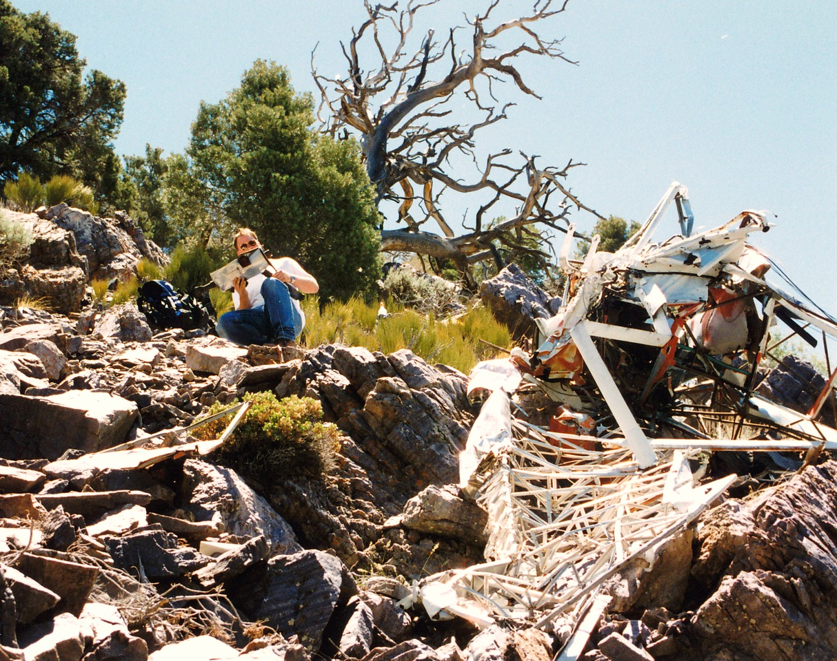The next day we drove out to the area of the crash site near the town of Pahrump. The hike up to the site took an hour or so of climbing the loose rocky terrain. When we reached the site, It became clear to us that the aircraft was not World War 2 vintage.