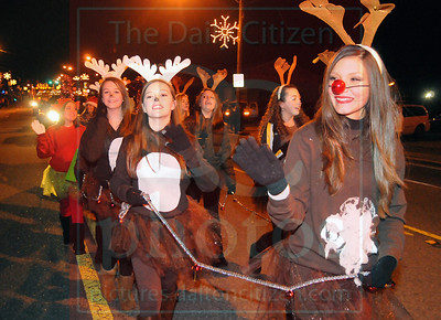 Matt Hamilton/The Daily Citizen Kenedie Sitton, 14, plays Rudolph as she walks in the parade with the Bagley Middle cheerleaders Saturday.