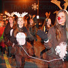 Matt Hamilton/The Daily Citizen<br /> Kenedie Sitton, 14, plays Rudolph as she walks in the parade with the Bagley Middle cheerleaders Saturday.