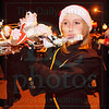 Matt Hamilton/The Daily Citizen<br /> Amber Rape, 17, plays her flute, decorated with Santa and his sleigh Saturday as she performs Christmas music with the North Murray High band.