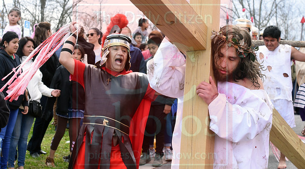 Matt Hamilton/Daily Citizen-News<br /> Rubin Trujillo, left, plays a soldier whipping Jesus, played by Jose Ortiz, during the Passion Play at St. Joseph's Catholic Church on Friday.