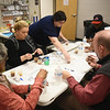 Matt Hamilton/Daily Citizen-News<br /> Judges taste test the different varieties of chili on Saturday at the Mack Gaston Community Center during the Democratic Party Chili fundraiser.