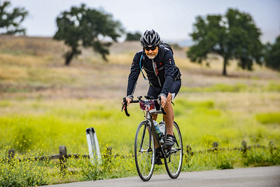 Steve Missouri rides past mustard flowers and oak trees along Figueroa Mountain Road