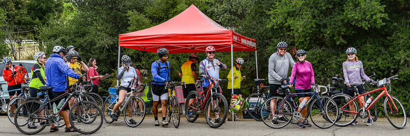 Riders check in at a SAG stop to hydrate, stretch, and reenergize