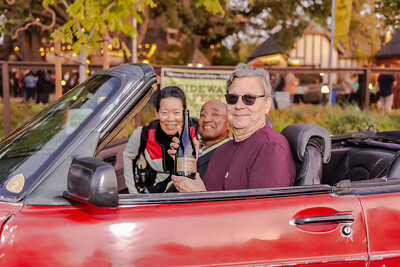 Rex Pickett, author of Sideways, unveils his new Sideways Pinot Noir from Chile (Rex Pickett Signature Series) from the driver's seat of the Saab from the movie.  He is accompanied by Solomon LeFlore and Susan Gee, Pickett's producing partners for the upcoming Sideways musical