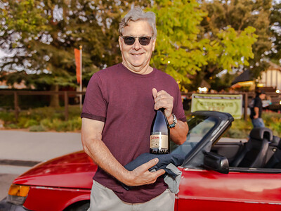 Rex Pickett, author of Sideways, unveils his new Sideways Pinot Noir from Chile (Rex Pickett Signature Series) as he stands next to the Saab from the movie