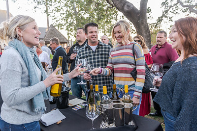 RaeLynn Zenzius (Kalyra Winery) pouring wine and bringing smiles to the Sideways Fest participants at the Solvang Festival Theater