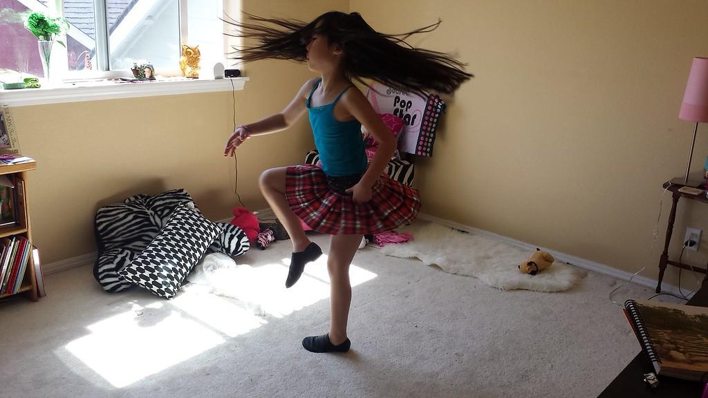 Dancing in her now empty room
