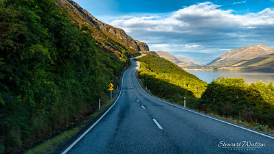 Scenic winding road along the edge of lake Wakatipu