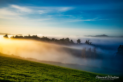 Exploring the Rural Hills of Berwick (south west of Dunedin) at sunrise on a freezing frosty day with low mist and fog rolling through the valleys