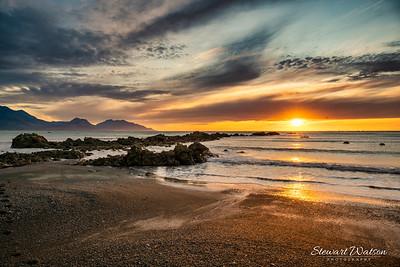 The golden sand on Kaikoura beach at sunrise