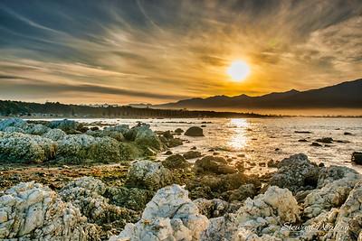 The rocky shore at Kaikoura shrouded in mist at sunrise