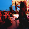 Youngster crowd the stage as SantaFe musical group Firecat of Discort dancer Evan Trujillo (Taos Pueblo) performs at the 6th annual Native American Music Festival June 10, 2000 at Dine' College in Tsaile, Ariz.