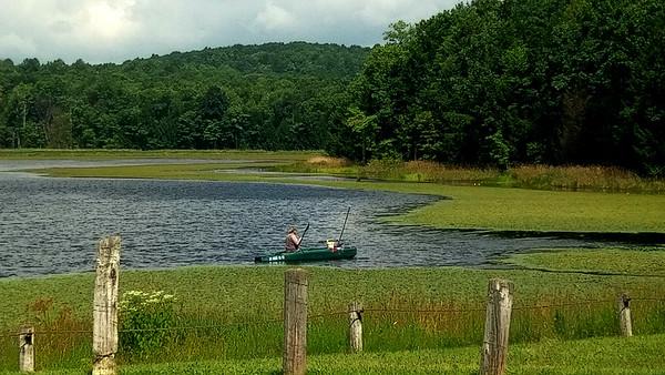 Kayak Fisherman at Hemlock Lake