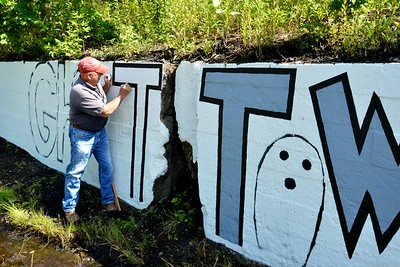 Repainting the Ghost Town Mural