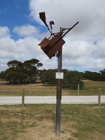 Home Made Windmill - Penong Windmill Museum - Penong, South Australia. This home made windmill was ona farm once owned by Ern Denton at Charra and was bought by Albert Brown in 1945 and in turn owned by Paul Brown in 1977. Believed to be made in the 1930's On loan from Paul Brown.