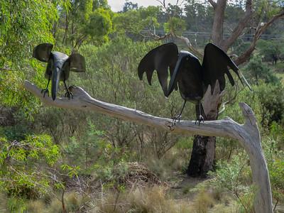 Tasmanian Bushland Garden - Buckland, Tasmania Currawong sculptures by Sally Brown