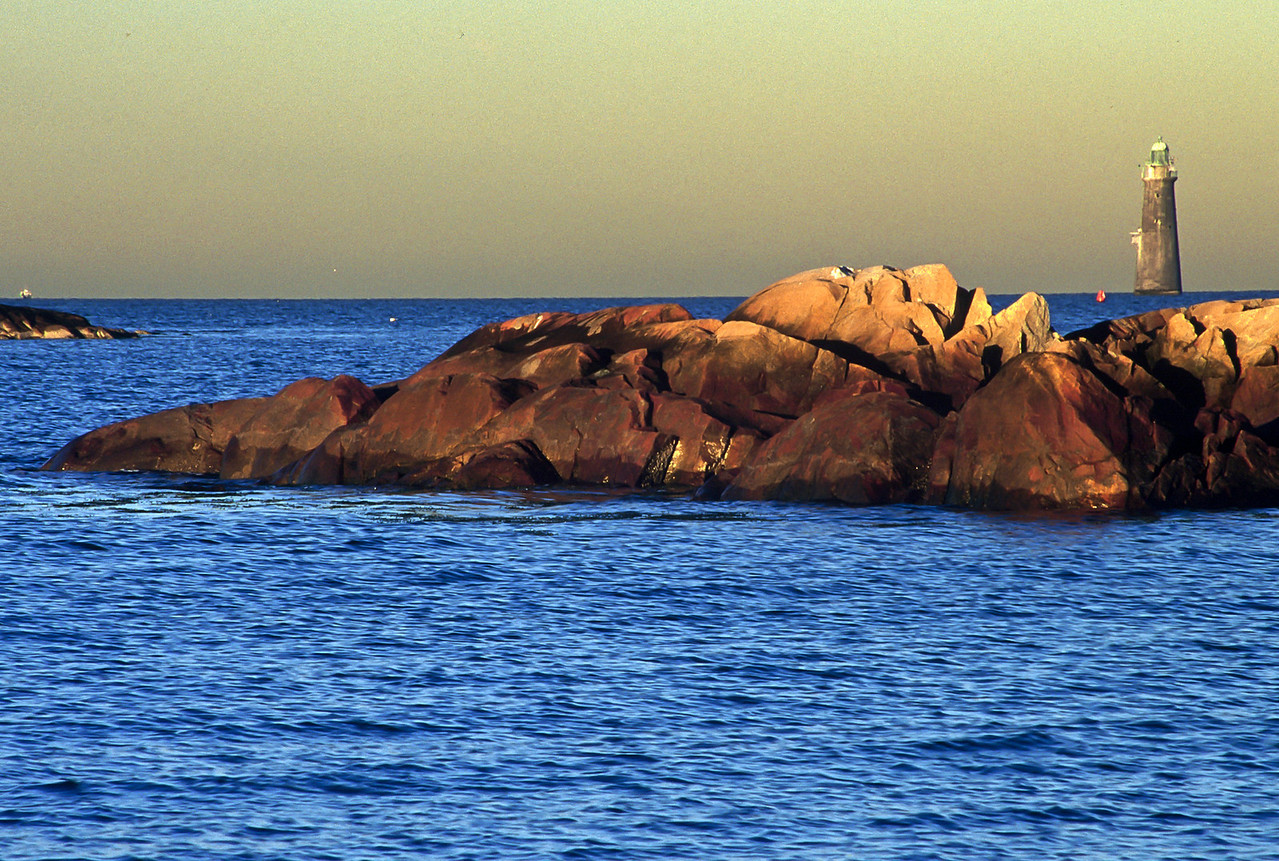 Minot Light sits out to sea beyond rocks at mid-tide, Cohasset, MA.