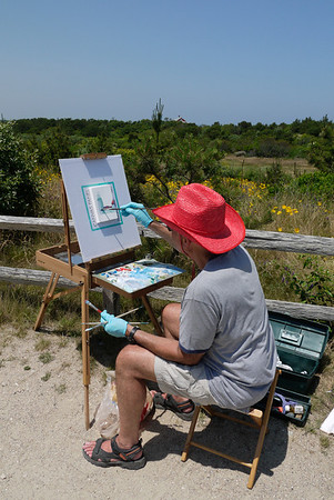 Artist at work, painting the lighthouse, Highland Light, Truro, MA.