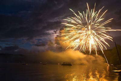 Fireworks bursting over Pasquaney Bay on Fourth of July, Newfound Lake, NH.