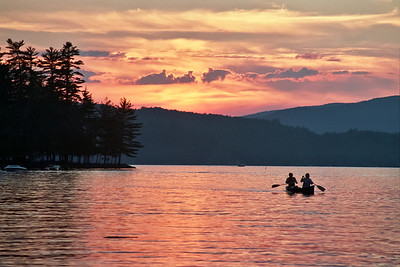 Canoe Paddlers at Sunset