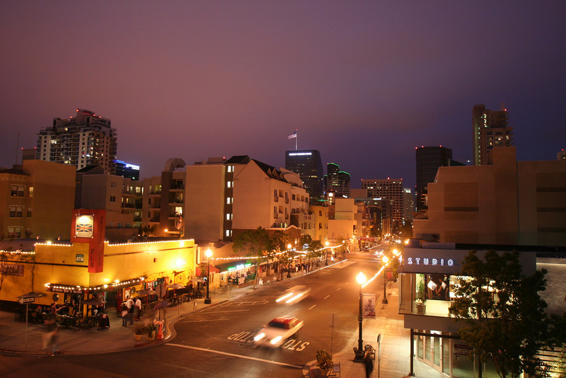 San Diego's charming Little Italy in the evening, with views on the skyline.