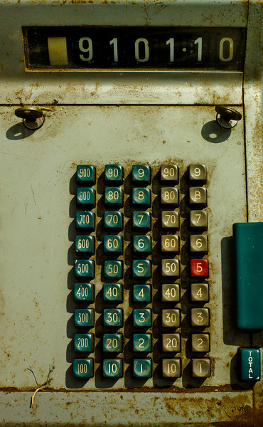 A grungy old vintage cash register in high contrast