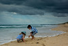 Heavy Clouds ahead of a Storm at Warana Beach.<br /> <br /> Tom and Eleanor studying a jellyfish