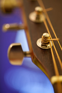 Tuning pegs of an acoustic guitar