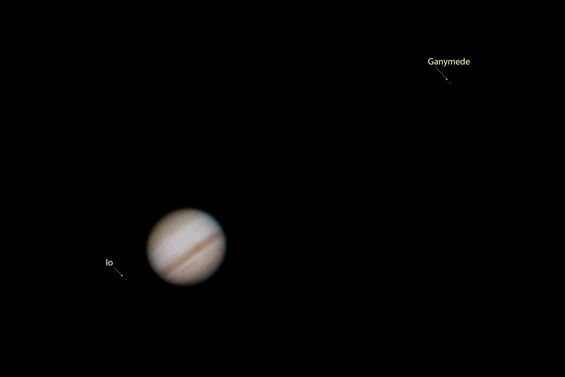 Jupiter with two of its moons (Io and Ganymede)