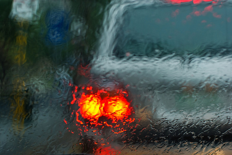 Abstracts taken through the front windscreen of the car on a rainy day in traffic
